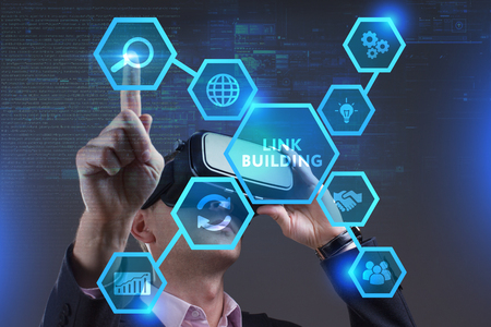 Business, Technology, Internet and network concept. Young businessman working on a virtual screen of the future and sees the inscription: Link building Stock Photo