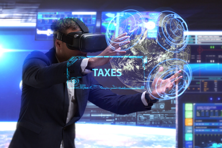 niche: Business, Technology, Internet and network concept. Young businessman working in virtual reality glasses sees the inscription: Taxes