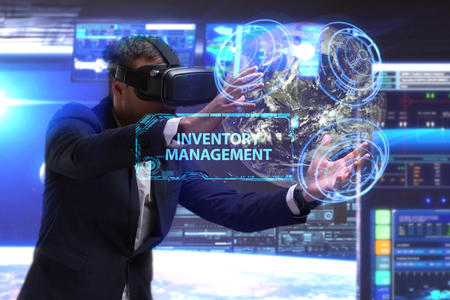 niche: Business, Technology, Internet and network concept. Young businessman working in virtual reality glasses sees the inscription: Inventory management