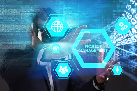 Business, Technology, Internet and network concept. Young businessman working in virtual reality glasses sees the inscription: Project management