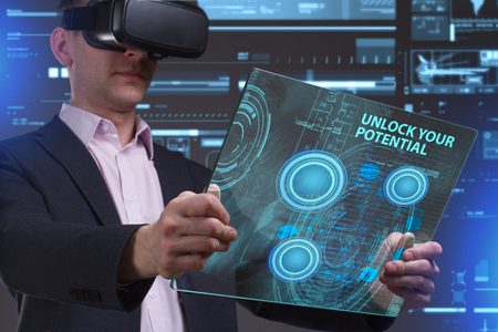 private security: Business, Technology, Internet and network concept. Young businessman working in virtual reality glasses sees the inscription: Unlock your potential