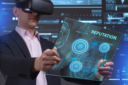 niche: Business, Technology, Internet and network concept. Young businessman working in virtual reality glasses sees the inscription: Reputation Stock Photo