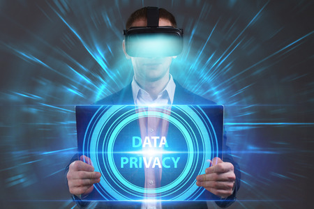 private security: Business, Technology, Internet and network concept. Young businessman working in virtual reality glasses sees the inscription: Data privacy