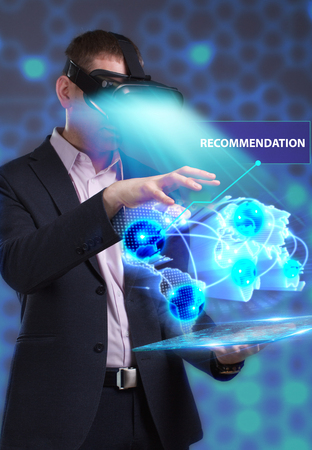 questions: Business, Technology, Internet and network concept. Young businessman working in virtual reality glasses sees the inscription: Recommendation