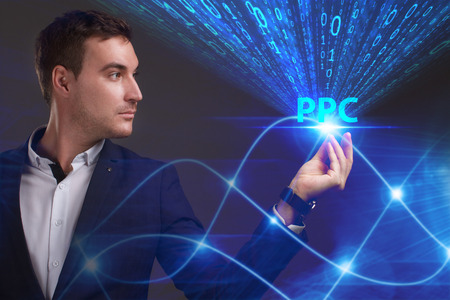 Business, Technology, Internet and network concept. Young businessman working on a virtual screen of the future and sees the inscription: PPC Stock Photo - 85611762