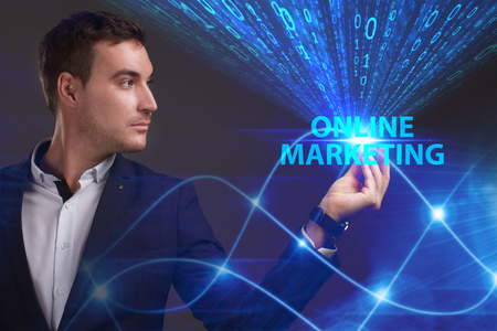 marketing online: Business, Technology, Internet and network concept. Young businessman working on a virtual screen of the future and sees the inscription: Online marketing