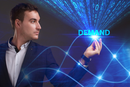 questions: Business, Technology, Internet and network concept. Young businessman working on a virtual screen of the future and sees the inscription: Demand Stock Photo