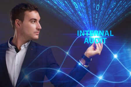 questions: Business, Technology, Internet and network concept. Young businessman working on a virtual screen of the future and sees the inscription: Internal audit