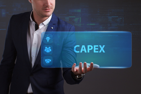 niche: Business, Technology, Internet and network concept. Young businessman working on a virtual screen of the future and sees the inscription: Capex Stock Photo