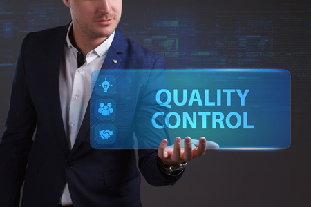 niche: Business, Technology, Internet and network concept. Young businessman working on a virtual screen of the future and sees the inscription: Quality control