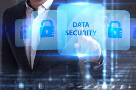 he: The concept of business, technology, the Internet and the network. The young entrepreneur has found what he needs: Data security Stock Photo