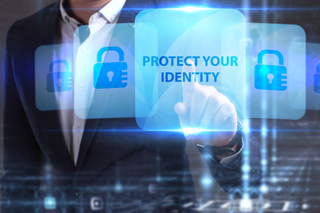 The concept of business, technology, the Internet and the network. The young entrepreneur has found what he needs: Protect your identity Banco de Imagens
