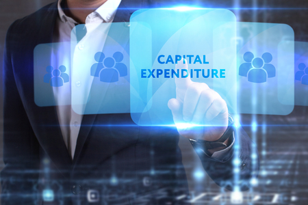 he: The concept of business, technology, the Internet and the network. The young entrepreneur has found what he needs: Capital expenditure