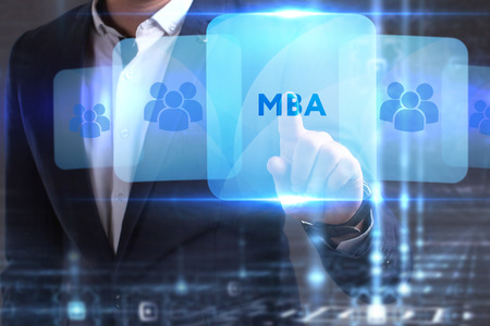 he: The concept of business, technology, the Internet and the network. The young entrepreneur has found what he needs: MBA Stock Photo