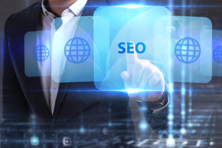 he: The concept of business, technology, the Internet and the network. The young entrepreneur has found what he needs: SEO