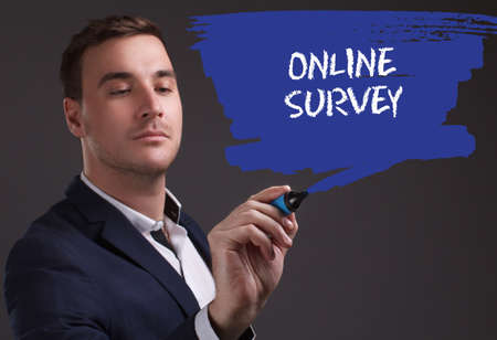 The concept of business, technology, the Internet and the network. Young businessman showing inscription: Online survey Stock Photo