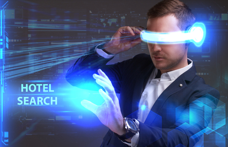 seo: Business, Technology, Internet and network concept. Young businessman working in virtual reality glasses sees the inscription: Hotel search