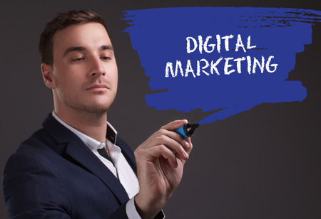 seo: The concept of business, technology, the Internet and the network. Young businessman showing inscription: Digital Marketing