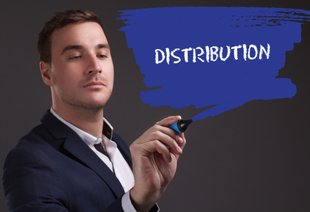 seo: The concept of business, technology, the Internet and the network. Young businessman showing inscription: Distribution Stock Photo