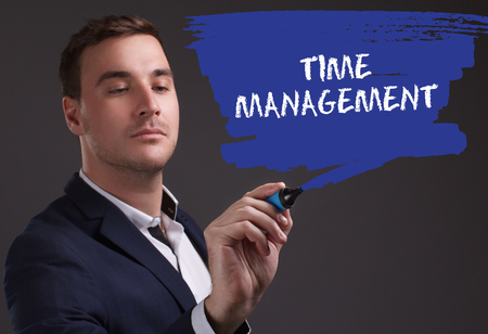 seo: The concept of business, technology, the Internet and the network. Young businessman showing inscription: Time management