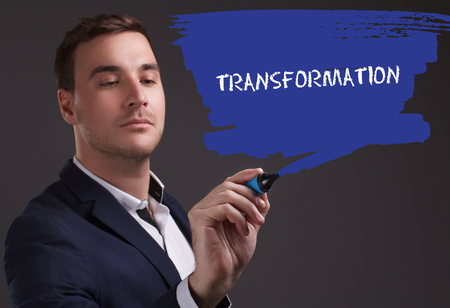 seo: The concept of business, technology, the Internet and the network. Young businessman showing inscription: Transformation