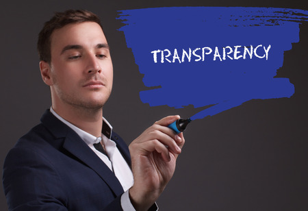 seo: The concept of business, technology, the Internet and the network. Young businessman showing inscription: Transparency