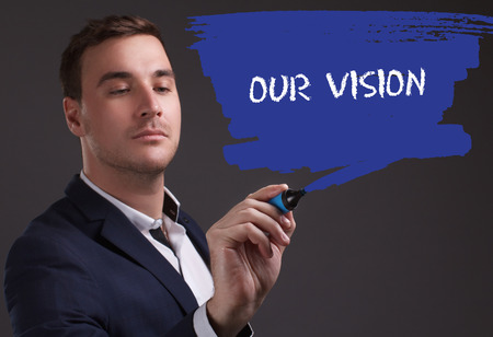 seo: The concept of business, technology, the Internet and the network. Young businessman showing inscription: Our vision