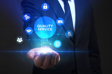 keywords: Business, Technology, Internet and network concept. Young businessman working on a virtual screen of the future and sees the inscription: Quality service Stock Photo