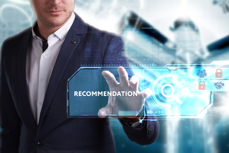 Business, Technology, Internet and network concept. Young businessman working on a virtual screen of the future and sees the inscription: Recommendation