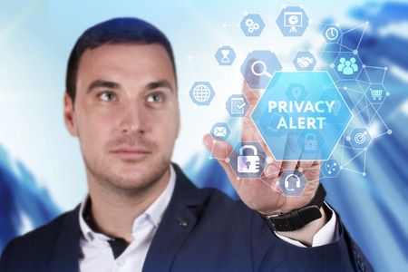 Business, Technology, Internet and network concept. Young businessman working on a virtual screen of the future and sees the inscription: Privacy alert 스톡 콘텐츠
