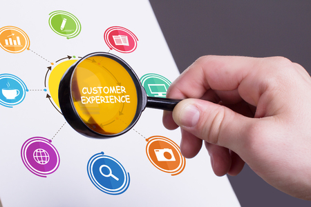 The concept of business, technology, the Internet and the network. Young businessman showing inscription: Customer experience Stock Photo