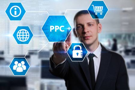Business, Technology, Internet and network concept. Young businessman working on a virtual screen of the future and sees the inscription: PPC