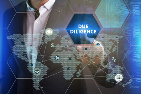 Business, Technology, Internet and network concept. Young businessman working on a virtual screen of the future and sees the inscription: Due diligence 스톡 콘텐츠