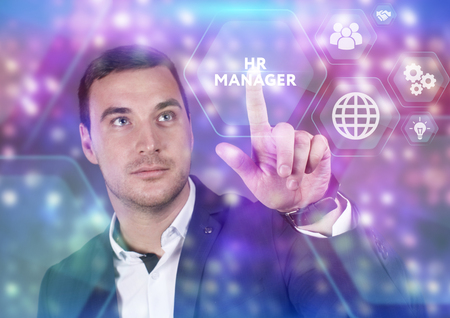 Business, Technology, Internet and network concept. Young businessman working on a virtual screen of the future and sees the inscription: HR manager Stock Photo