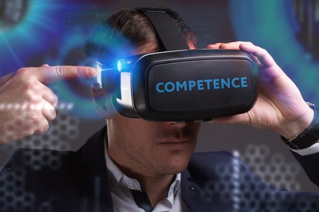 Business, Technology, Internet and network concept. Young businessman working in virtual reality glasses sees the inscription: Competence Stock fotó