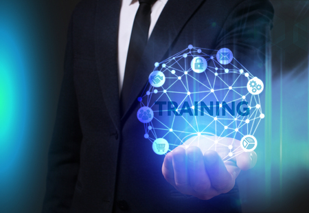Business, Technology, Internet and network concept. Young businessman working on a virtual screen of the future and sees the inscription: Training Stock Photo