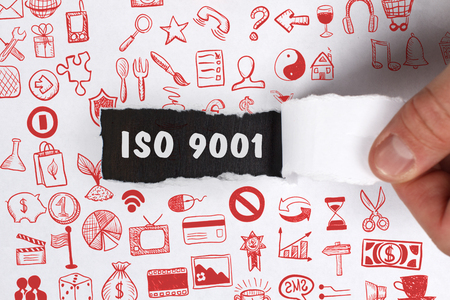 The concept of business, technology, the Internet and the network. Young businessman showing inscription: ISO 9001