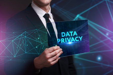 Business, Technology, Internet and network concept. Young businessman working on a virtual screen of the future and sees the inscription: Data privacy Banque d'images