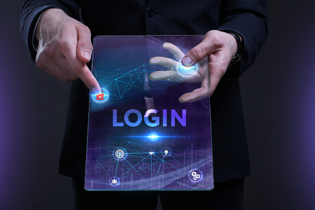 Business, Technology, Internet and network concept. Young businessman working on a virtual screen of the future and sees the inscription: Login