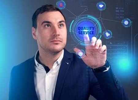 Business, Technology, Internet and network concept. Young businessman working on a virtual screen of the future and sees the inscription: Quality service Stock fotó