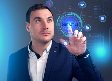 Business, Technology, Internet and network concept. Young businessman working on a virtual screen of the future and sees the inscription: Contact us Stock fotó