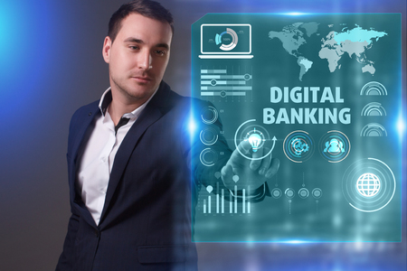 Business, Technology, Internet and network concept. Young businessman working on a virtual screen of the future and sees the inscription: Digital banking Archivio Fotografico
