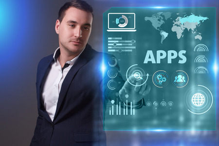 Business, Technology, Internet and network concept. Young businessman working on a virtual screen of the future and sees the inscription: APPS Stockfoto