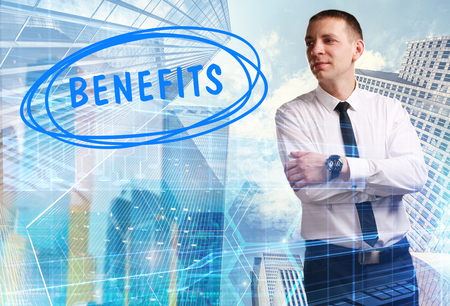 The concept of business, technology, the Internet and the network. Young businessman showing inscription: Benefits Stock Photo