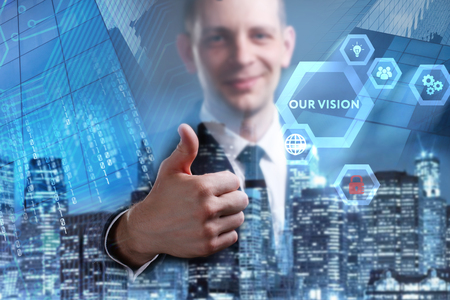 Business, Technology, Internet and network concept. Young businessman working on a virtual screen of the future and sees the inscription: Our vision 写真素材 - 102411973