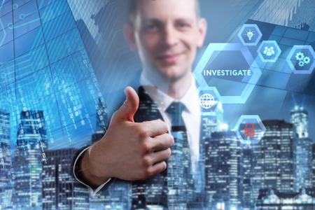 Business, Technology, Internet and network concept. Young businessman working on a virtual screen of the future and sees the inscription: Investigate Stock fotó