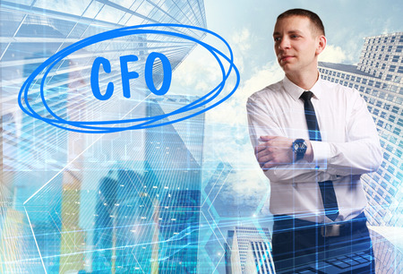 The concept of business, technology, the Internet and the network. Young businessman showing inscription: CFO Stock Photo