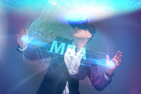 Business, Technology, Internet and network concept. Young businessman working in virtual reality glasses sees the inscription: MBA Archivio Fotografico