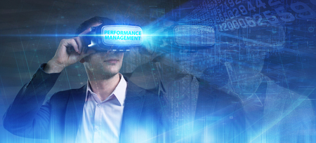 Business, Technology, Internet and network concept. Young businessman working in virtual reality glasses sees the inscription: Performance management Stock Photo