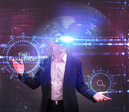 Business, Technology, Internet and network concept. Young businessman working in virtual reality glasses sees the inscription: Time management
